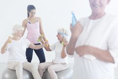 Elderly friends laughing during exercise stock images