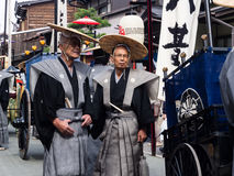 Two elderly Japanese men in traditional samurai costumes royalty free stock images