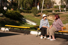 Two elderly ladies in the park Stock Photo