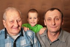 Two elderly men with boy Royalty Free Stock Photography