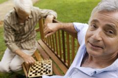 Two elderly men playing chess. Royalty Free Stock Images