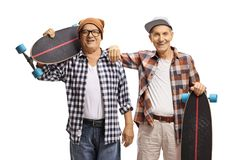 Two elderly men skaters with longboards royalty free stock images