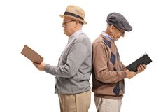 Two elderly men with their backs against each other reading book. S isolated on white background royalty free stock image