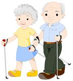 Two elderly people nordic walking Stock Images