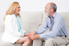 Two elderly persons looking at each other. Senior couple with positive emotions royalty free stock photo