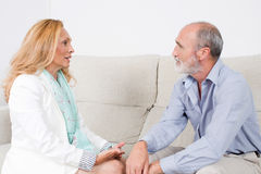 Two elderly persons looking at each other. Senior couple with positive emotions stock photos