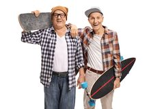 Two elderly skaters with longboards looking at the camera and sm Royalty Free Stock Images