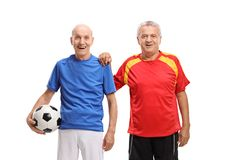 Two elderly soccer players. Isolated on white background royalty free stock photo