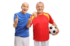 Two elderly soccer players making thumb up signs Stock Photos