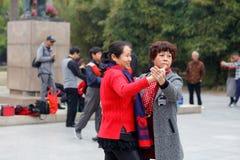 Two elderly women dancing tango, srgb image