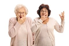 Two elderly women gesturing surprise. Isolated on white background royalty free stock photo