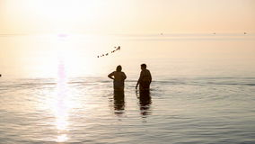 Two elderly women go swimming at sunrise. Two elderly women go swimming in the sea at sunrise stock video