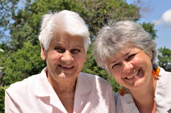 Two elderly women laugh Stock Image