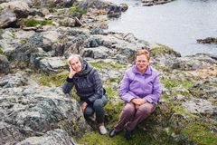 Two elderly women near the river stock photo