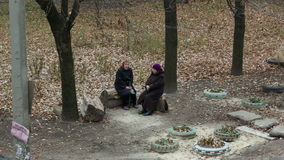 Two Elderly Women Sitting and Talking stock video