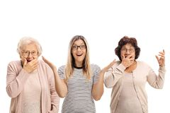 Two elderly women and a young woman making surprise gestures. Two elderly women and a young women making surprise gestures isolated on white background Stock Photography