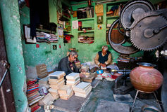 Two elderly workers repairing old books in a workshop royalty free stock photos
