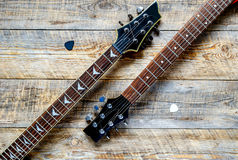 Two electric guitar bodies on wooden board background. Royalty Free Stock Photos