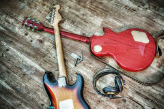 Two electric guitars and headphones in hdr Stock Photos