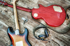 Two electric guitars and headphones in hdr Royalty Free Stock Photography