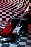 Two electric guitars and sound amplifying equipment Royalty Free Stock Photos