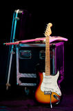 Two Electric Guitars With A Crate And A Case Royalty Free Stock Photo