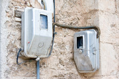 Two electric meters on  wall in smalll traditional Greek village Kalavrita, Peloponnese. Greece Stock Images