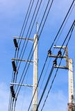 Two electric pole and blue sky stock images