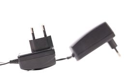 Two electric power adapters. Close up. Royalty Free Stock Image