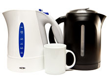Two electric tea kettle on a white background and a mug Royalty Free Stock Image
