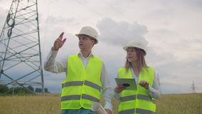 Two Electrical engineer working. Talking and working working on a laptop.Checking the power grids.  stock footage