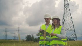 Two Electrical engineer working. Talking and working working on a laptop.Checking the power grids.  stock video footage