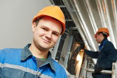 Two electrician worker at cabling royalty free stock photography