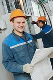 Two electrician workers Stock Photo