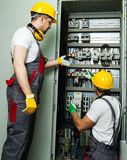 Two electricians on a factory royalty free stock photo