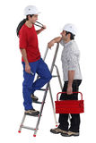 Two electricians having at chat Royalty Free Stock Image