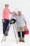 Two electricians with a ladder Stock Photo