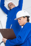 Two electricians in room under construction. Two electricians in a room under construction stock images