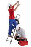 Two electricians working Stock Photography