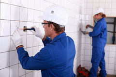 Two electricians Stock Images