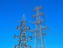 Two electricity pylons Stock Photos