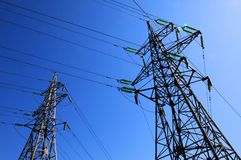 Two electricity pylons Royalty Free Stock Photos