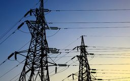 Two electricity pylons royalty free stock images