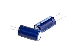 Two electrolytic capacitor in blue Royalty Free Stock Photos