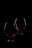 Two elegant brandy glasses. On black background Royalty Free Stock Photography