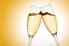 Two elegant champagne glasses Stock Photos
