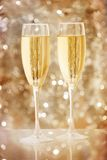 Two elegant champagne glasses Stock Images