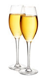 Two elegant champagne glasses close-up isolated on a white background. Festive still life. Royalty Free Stock Photos