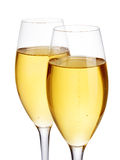 Two elegant champagne glasses close-up  on a white background. Festive still life. Royalty Free Stock Photo