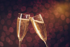 Two elegant champagne glasses making toast. On holiday bokeh background Royalty Free Stock Image